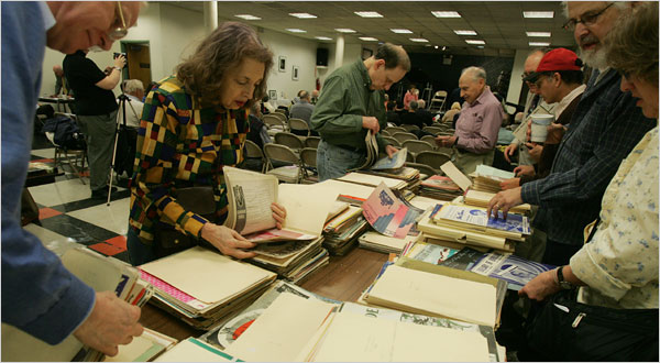 Members of the New York Sheet Music Society going through a vendor's files to search for favorites before a meeting. Photo by Hiroko Masuike for The New York Times